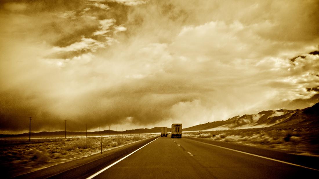 Twin Trucks Heading South Towards Storm - Owens Valley, CA - 2013