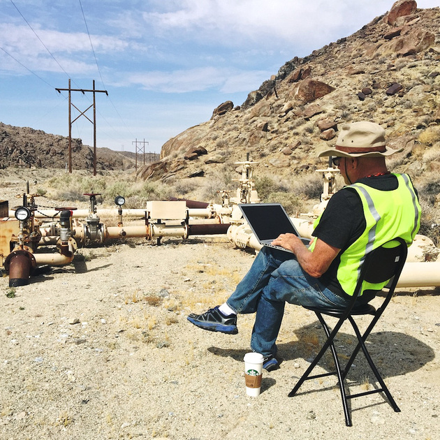 Christopher Langley on Laptop at Water Throttling Valves - Poison Canyon, CA - 2015